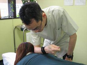 肩こり・首こりの治療:ほぐし.jpg